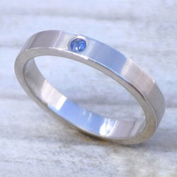 Fairtrade blue sapphire band in 18ct white gold