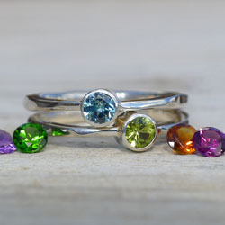A selection of stacking rings with fairtrade gemstones