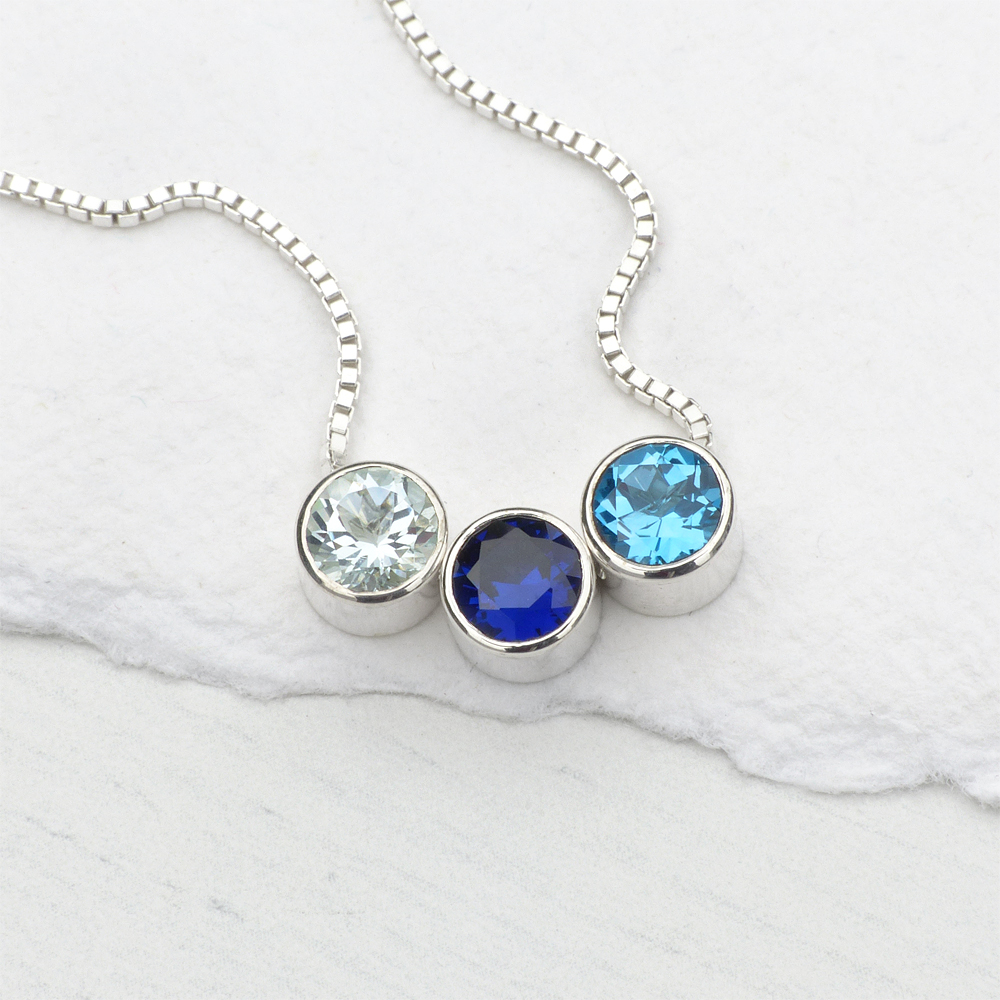 birthstone necklace with aquamarine, sapphire and blue topaz