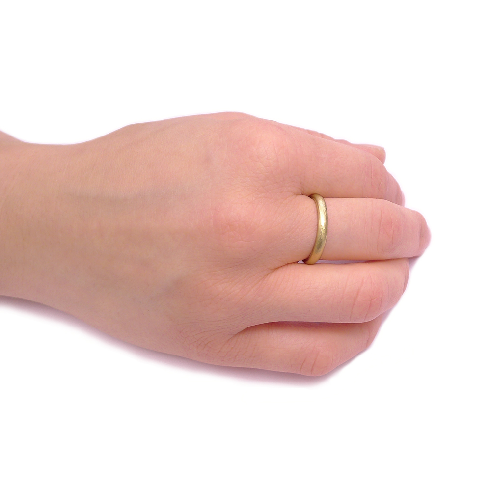 3mm Hammered Gold Ring on the Hand