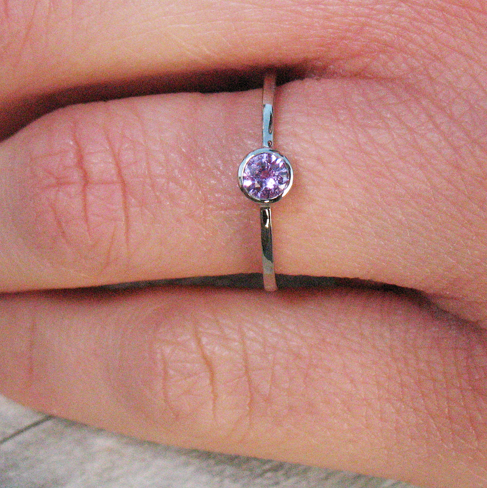 Pink Sapphire Solitaire Ring on the hand