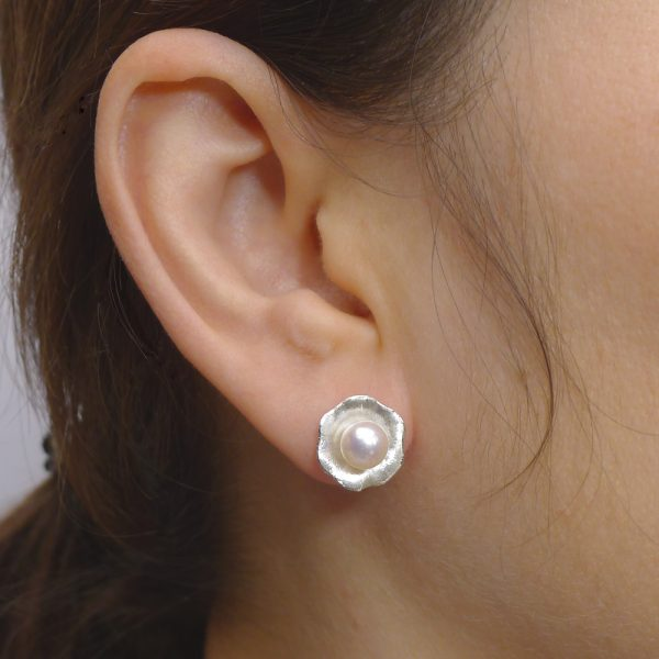 Pearl Flower Earrings in the ear