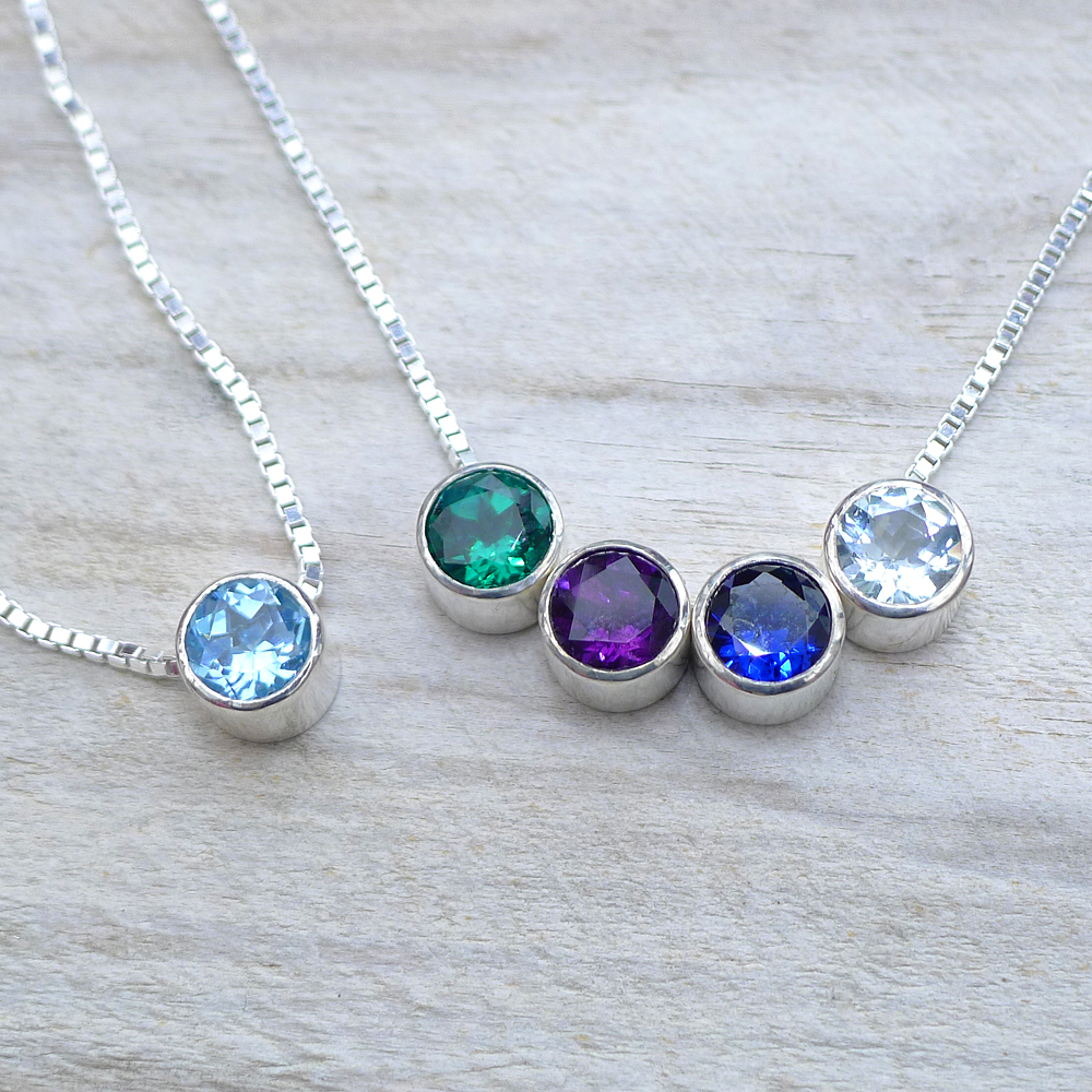 Blue Topaz Birthstone Necklace (right) and Emerald, Amethyst, Sapphire and Aquamarine Birthstone Necklace
