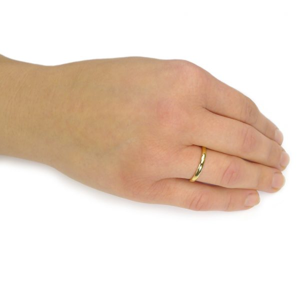 Comfort Fit Gold Wedding Ring on the hand