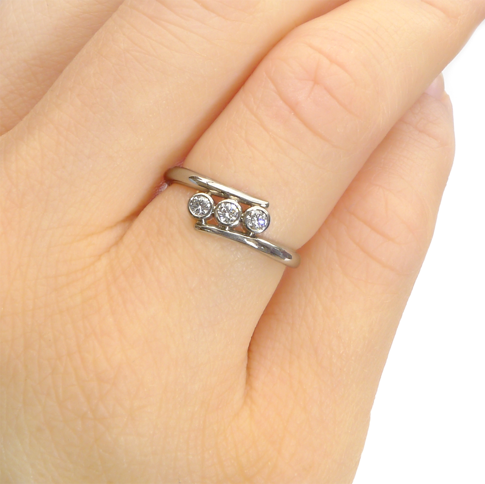 Triple Diamond Engagement Ring on the hand