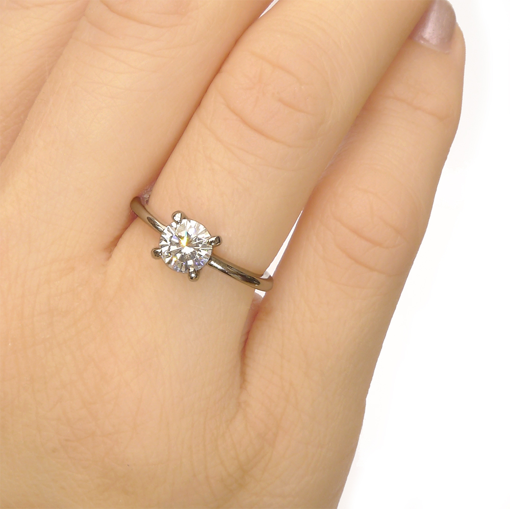 Moissanite Engagement Ring on the hand