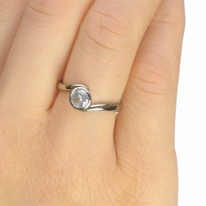 White Sapphire Ring in Swirl Design, on the hand