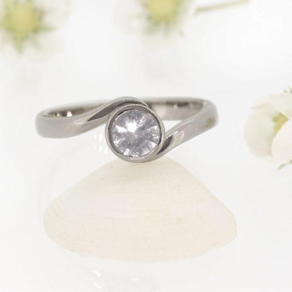 White Sapphire Ring in Swirl Design
