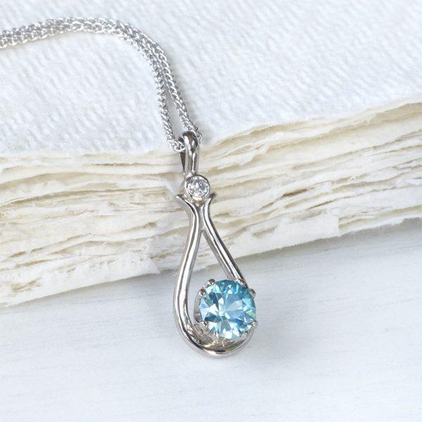 Blue zircon and diamond pen