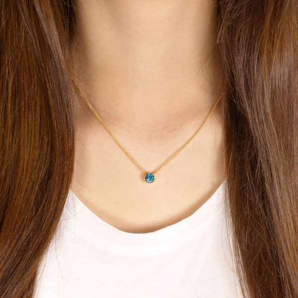 blue topaz necklace in 18ct gold