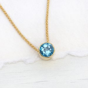 blue topaz necklacein 18ct gold