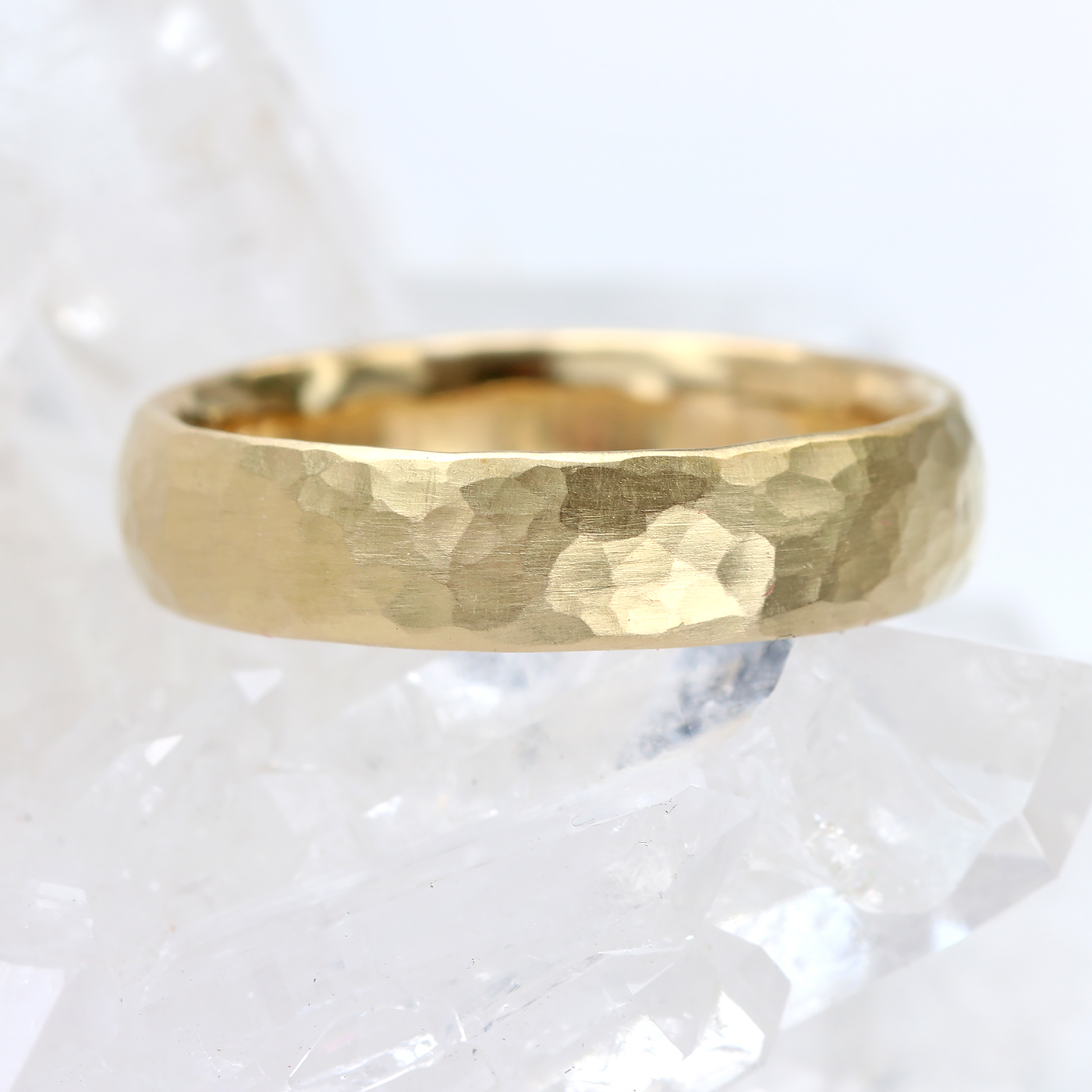 It is a picture of Hammered Wedding Ring in 422ct Gold or Platinum, 42mm Wide Comfort Fit
