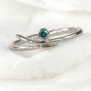 blue diamond accent ring
