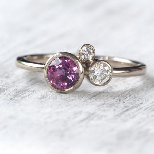 purple sapphire diamond cluster ring in 18ct white gold