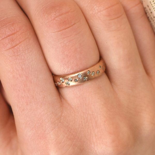 rose gold scattered diamond ring in gold