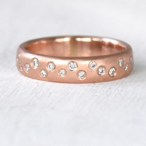 scattered diamond ring in gold