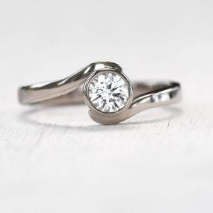 white sapphire wave ring