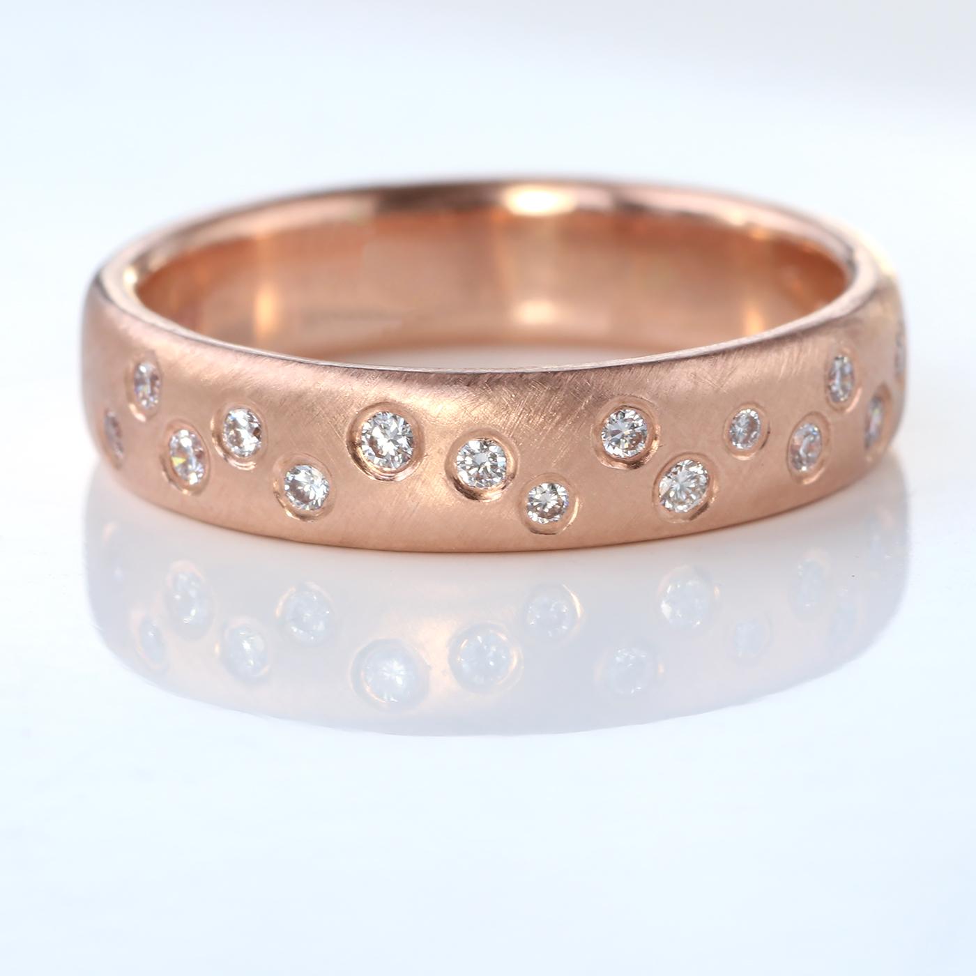 scattered diamond eternity ring rose gold