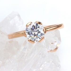 moissanite engagement ring with flower design