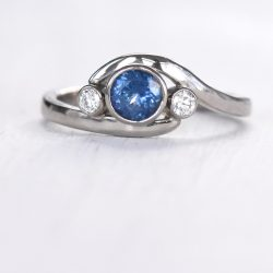 blue sapphire and diamond wave ring