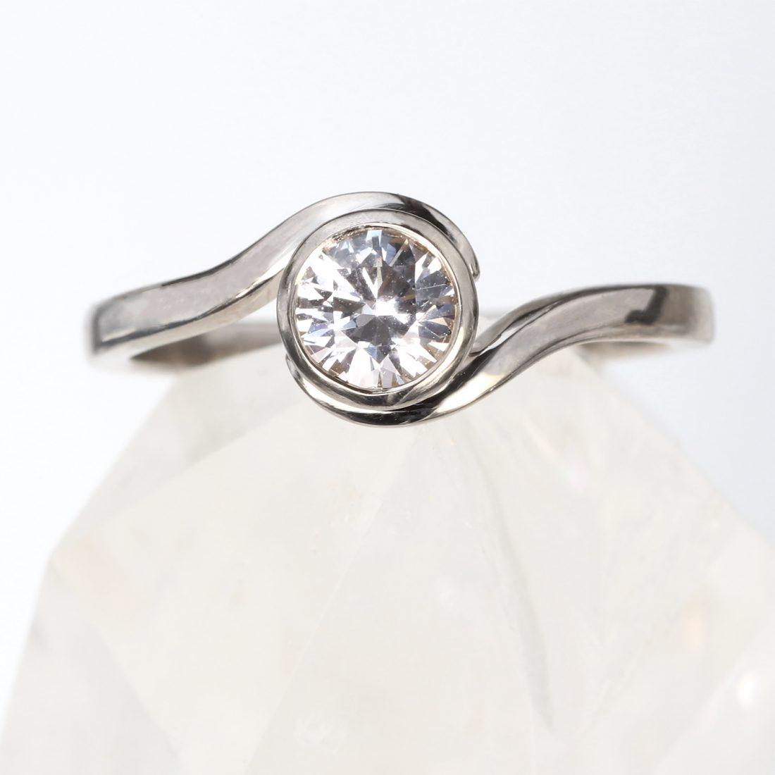 white sapphire swirl ring