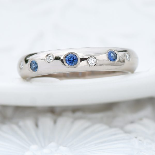 blue sapphire and diamond eternity ring