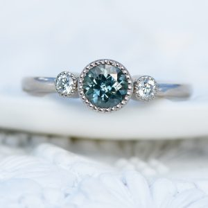 fair trade teal sapphire and diamond engagement ring