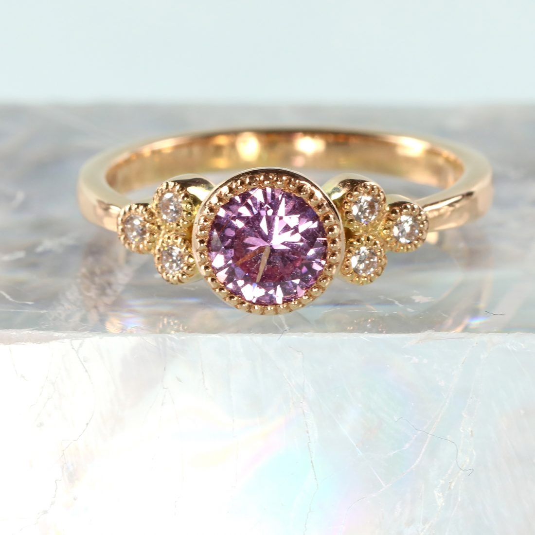 purple sapphire diamond cluster ring