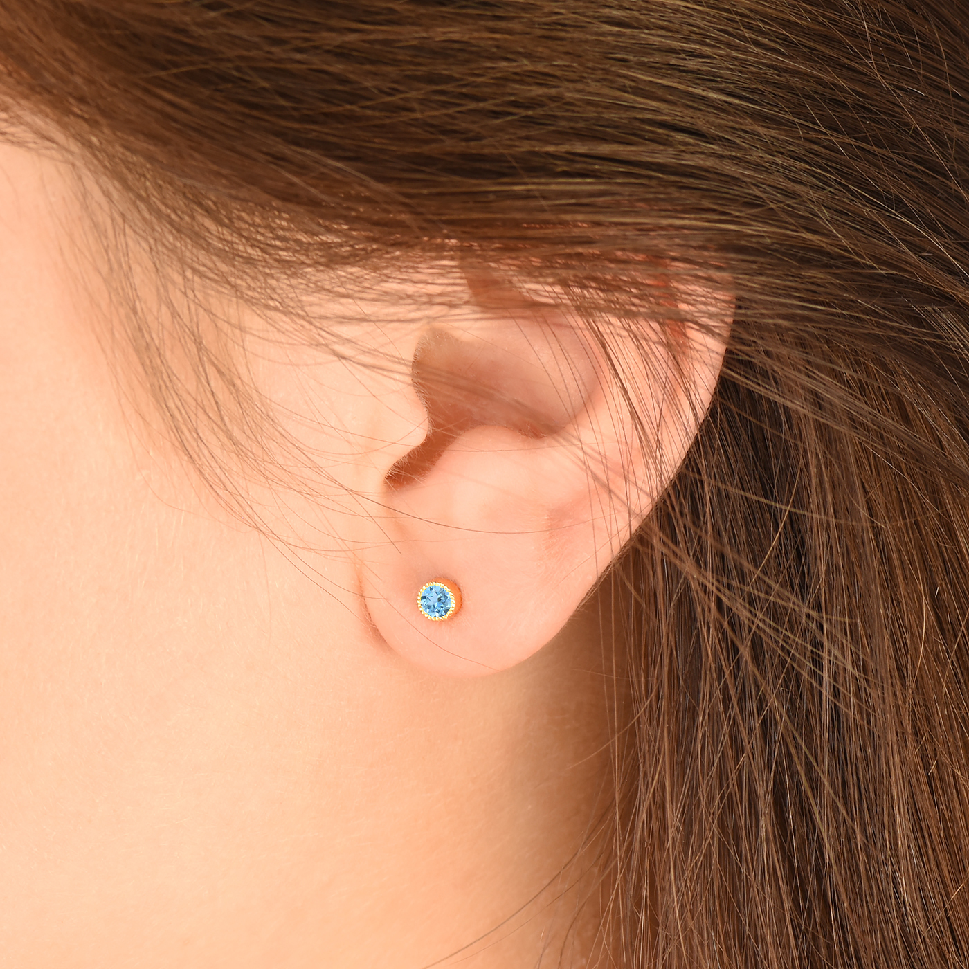 blue topaz stud earrings 18ct gold