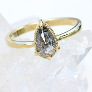 pear cut salt and pepper diamond ring