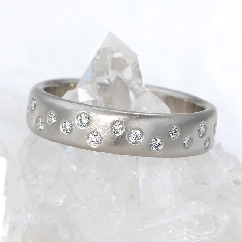 Platinum scattered diamond eternity/wedding band