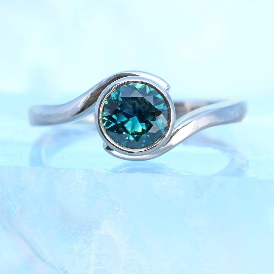 green sapphire swirl ring