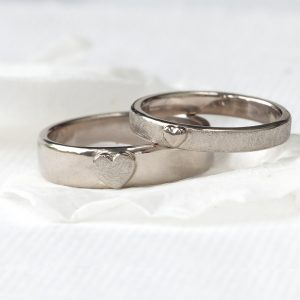 Matching 18ct white gold wedding rings with heart detail. Lilia Nash bespoke wedding ring design.