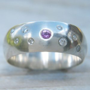 A Lilia Nash bespoke chunky wedding ring in 18ct white gold with diamonds & purple sapphires.