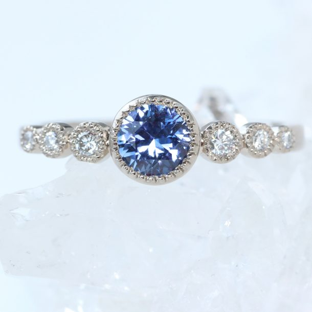 blue sapphire graduated diamond engagement ring