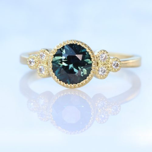 teal sapphire and diamond cluster ring