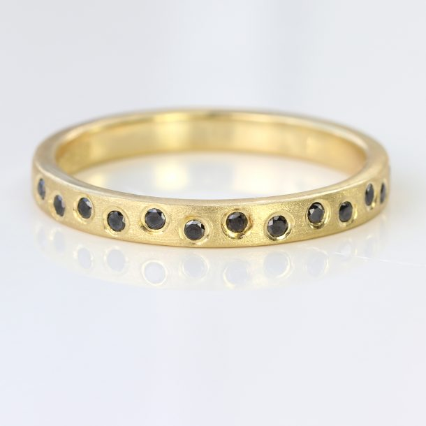 black diamond eternity ring yellow gold