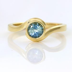 teal sapphire swirl ring