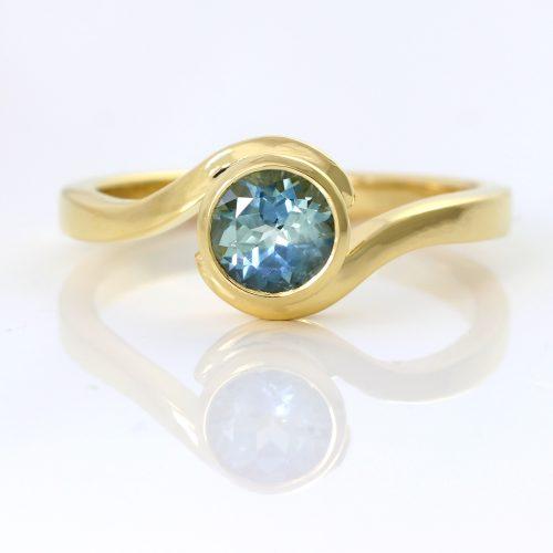 teal sapphire swirl ring