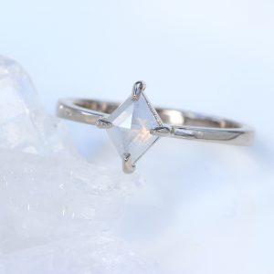 Kite shape diamond engagement ring in 18ct white gold