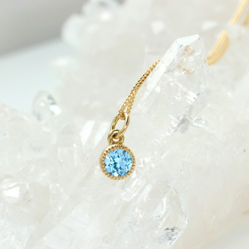 Ethical birthstone jewellery by Lilia Nash - December blue topaz 18ct gold pendant & chain. Matching earrings & rings available.