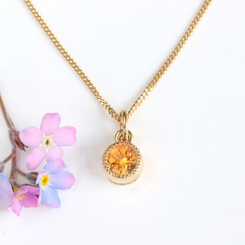 Fair trade citrine pendant in a petite solid 18ct gold pendant with pretty milgrain detail.  Citrine is the birthstone for November.