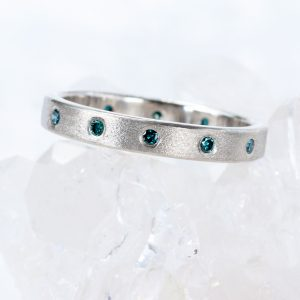 Bespoke Teal Sapphire Eternity Ring in Platinum
