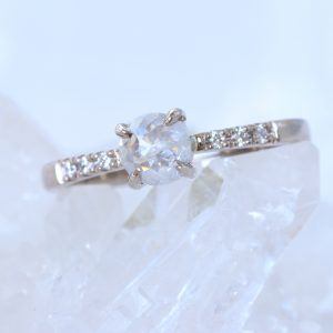 Unique icy rose cut diamond engagement ring, with pave site diamonds. Available in 18ct white gold