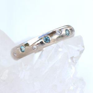 montana-blue-sapphire-diamond-band