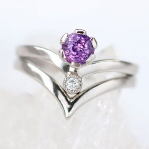A bespoke platinum engagement ring and wedding ring set by Lilia Nash featuring an ethical purple sapphire and fairtrade diamond.
