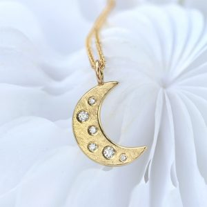 diamond moon pendant in 18ct gold