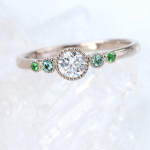 Bespoke engagement ring, set with a diamond, seafoam tourmaline and tsavorite, in 18ct white gold.
