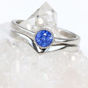 Royal blue sapphire engagement ring wishbone set in platinum, size L. Can be resized.