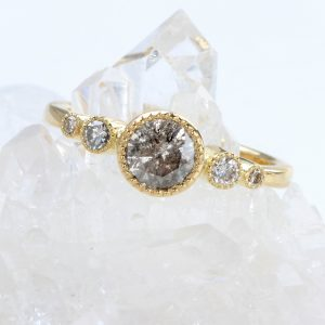 One of kind salt and pepper diamond ring with graduating diamonds. Handmade in 18ct gold and available in size L